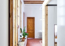 Large-windows-and-exposed-wooden-beams-showcase-the-past-of-the-apartment-217x155