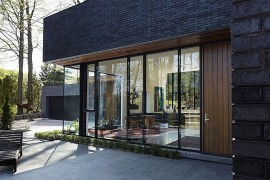 Large windows and sliding doors allow natural light into the front living spaces