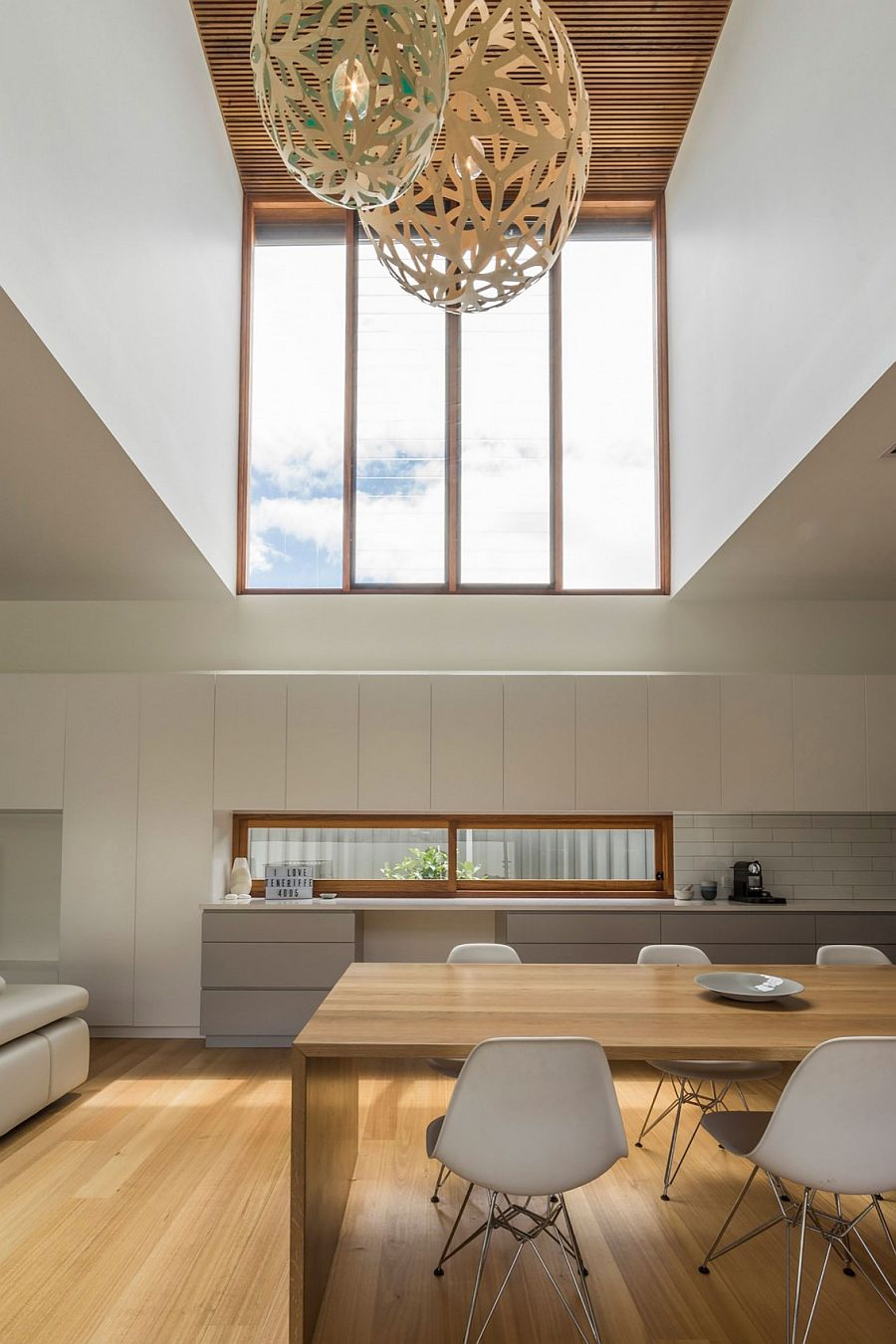 Large windows bring in a flood of natural light into the living area on the lower level