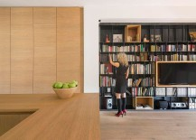 Large wooden shelves and boxes give the interior a curated minimal appeal 217x155 60s Italian Apartment Renovated Using Wood, Iron and Three Large Boxes!