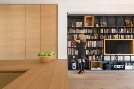 Large wooden shelves and boxes give the interior a curated, minimal appeal