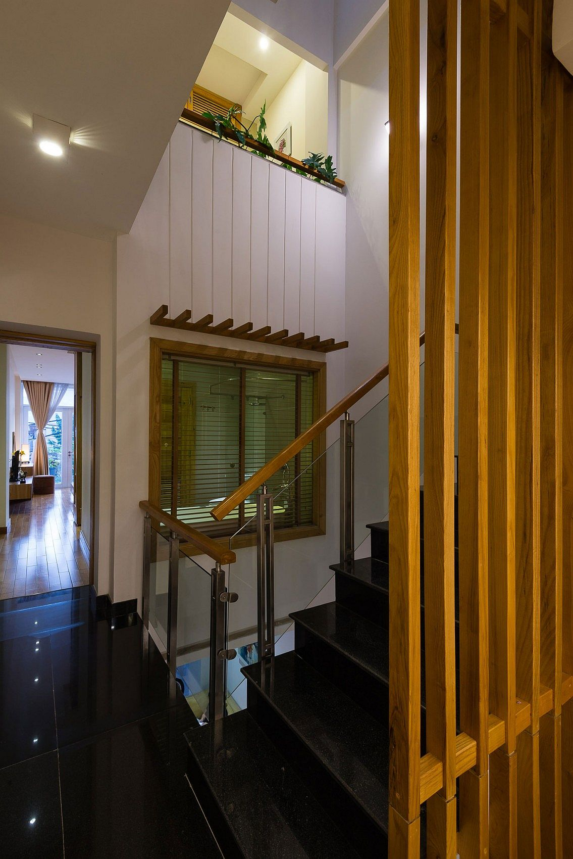 Light well next to the brings illuminates the various levels of the narrow home