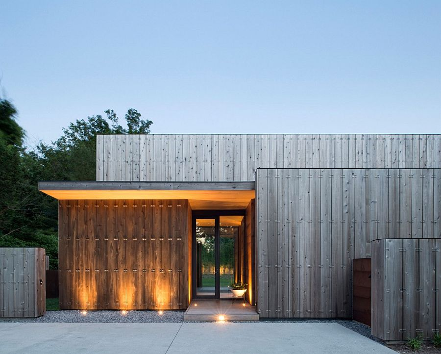 Lighting adds to the unique appeal of the home clad in cedar boards