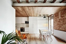 Living area, kitchen and dining room of the small tourist apartment in Barcelona