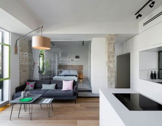 Custom, Space-Saving Partitions Transform Tiny Apartment in Tel Aviv