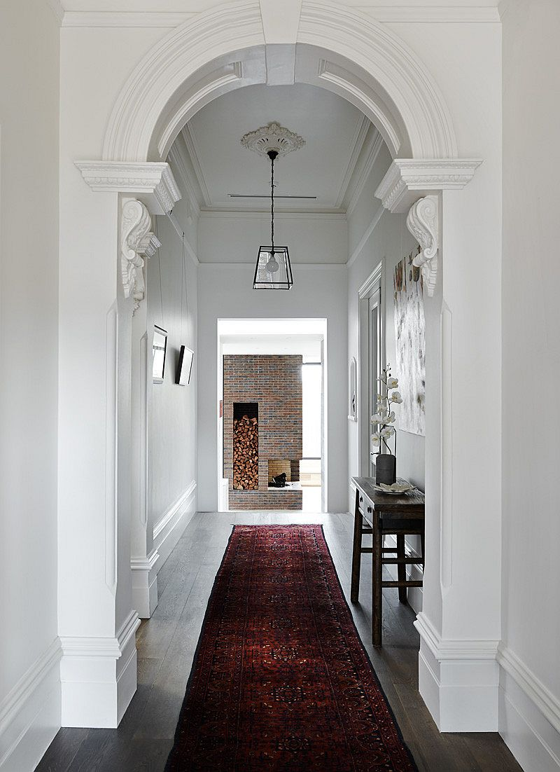 Long hallway connects the old and new elements of the home