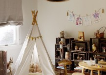Lovely, open shelves next to the teepee add to the modern rustic style of the room