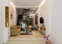 Lower level living area of the modern home in Vietnam 217x155 Versatile Narrow House in Ho Chi Minh City Beats the Space Crunch