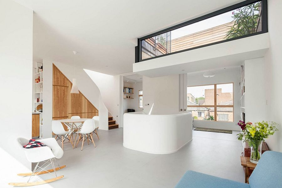 Lowered roof terrace section becomes a part of the living room visual