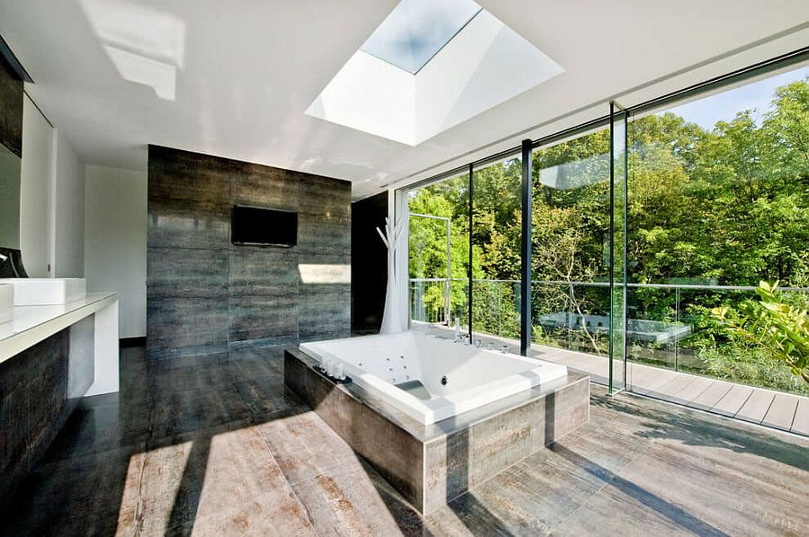 Lush green canopy outside adds color to the minimal bathroom