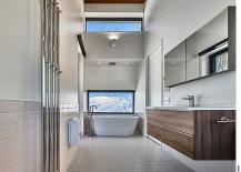 Master bathroom of the ski chalet with hexagonal floor tiles and windows