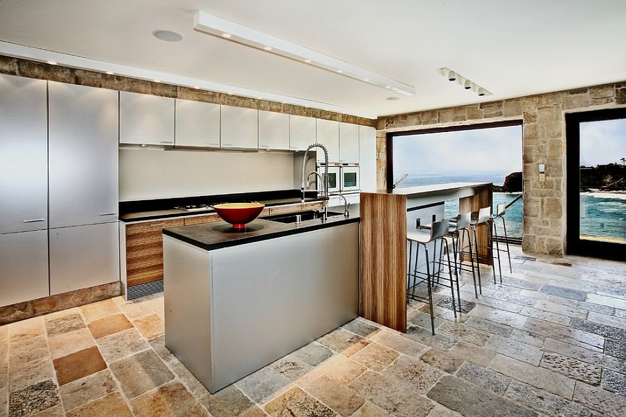 Mediterranean kitchen with ocean view clad in Reclaimed Biblical Limestone [Design: Neolithic Design Stone and Tile]