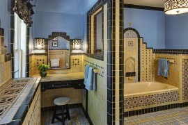 Mediterranean style bathroom with ornate design and a splah of blue