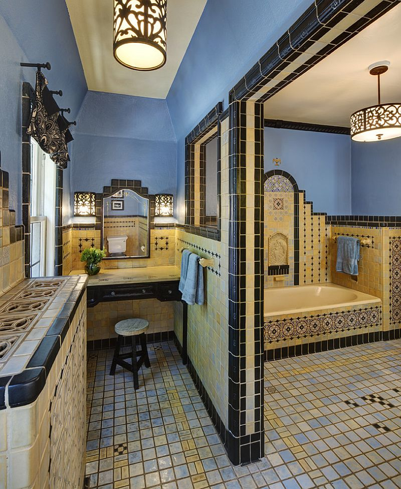 Mediterranean style bathroom with ornate design and a splash of blue [Design: HB Designs]