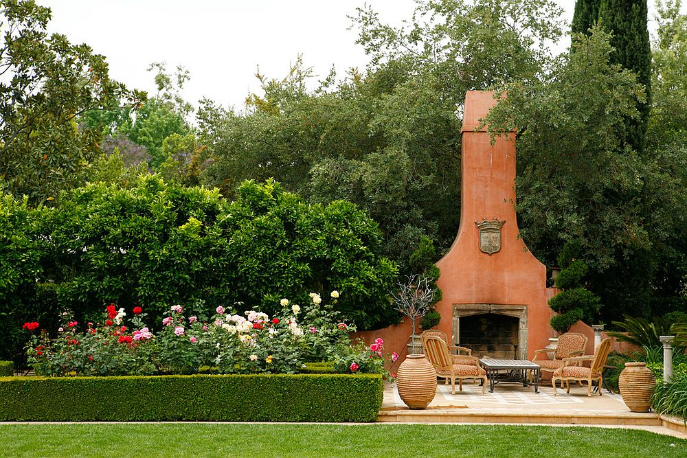 Mediterranean style patio with a striking fireplace that matches its style