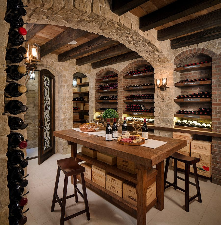 View In Gallery Mediterranean Wine Cellar And Tasting Room With Stone Walls  [Design: KW Designs]