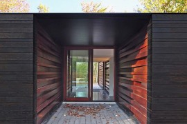 Milled lumber with glossy finish stacked at different angles to create an inimitable entry