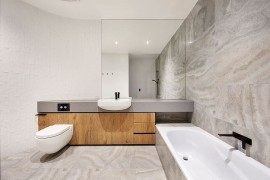 Minimal bathroom design in white and gray with curved wall