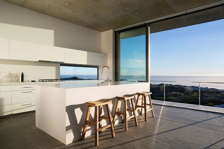 Minimal kitchen of Cape Town home with a stunning view of the distant Indian Ocean [Design: Gavin Maddock Design Studio]