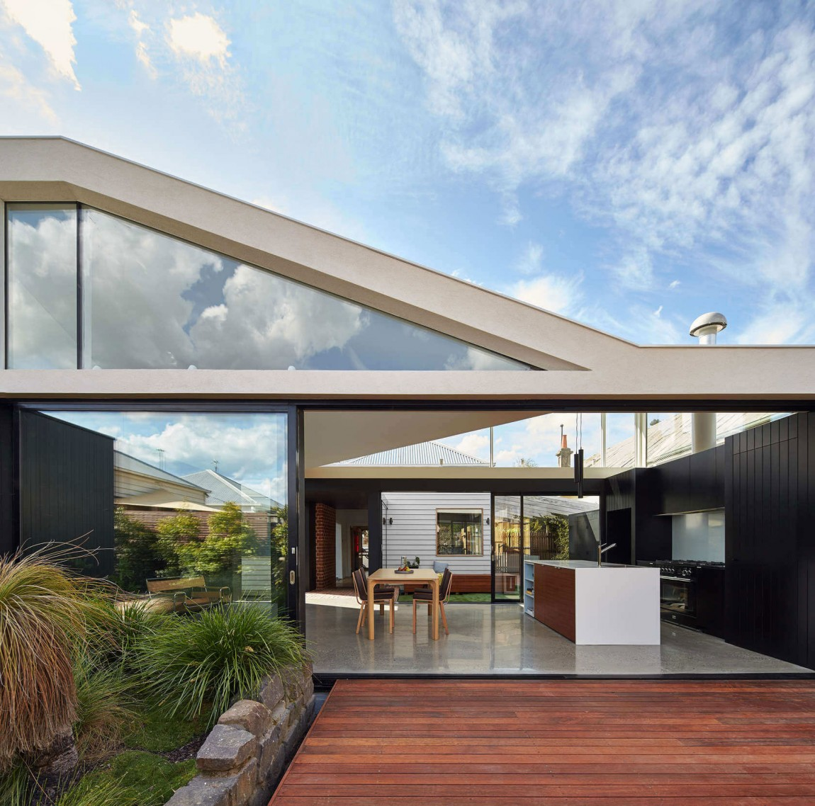 Modern addition adds a cool courtyard and stylish living space to Aussie home