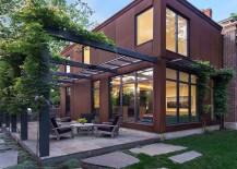 Cor-Ten Steel Structure Gives Georgian Revival Home a Modern Facelift