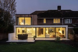 Modern extension stands out in contrast to classic brick facade