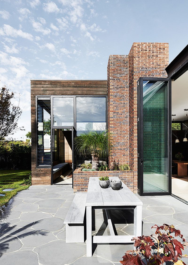 Modern glass doors and classic brick layout come together at the classy Malvern home