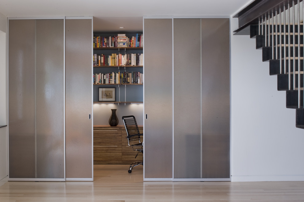 Modern home office with sliding translucent glass doors [Design: John Lum Architecture]