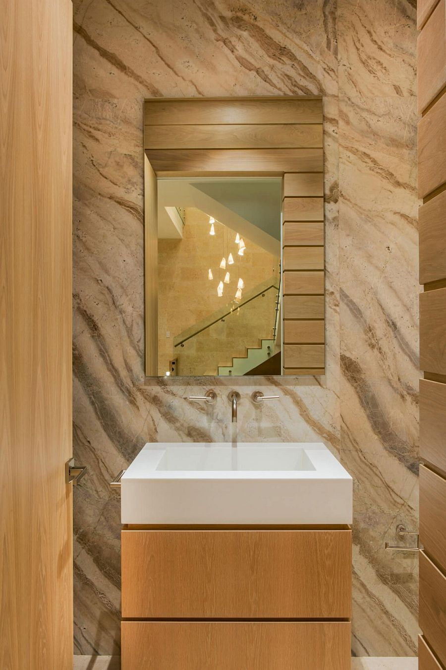 Modern powder room with stone backdrop