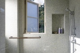 Multiple shower heads in a tiled bathroom