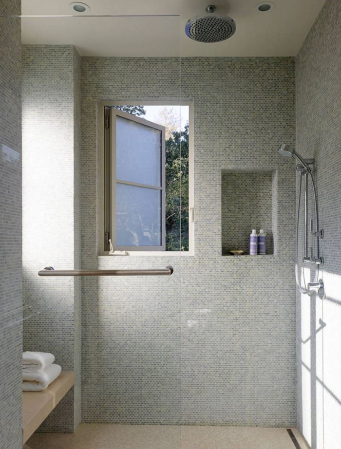 Multiple shower heads in a tiled bathroom