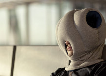 person uses Ostrich Pillow to nap