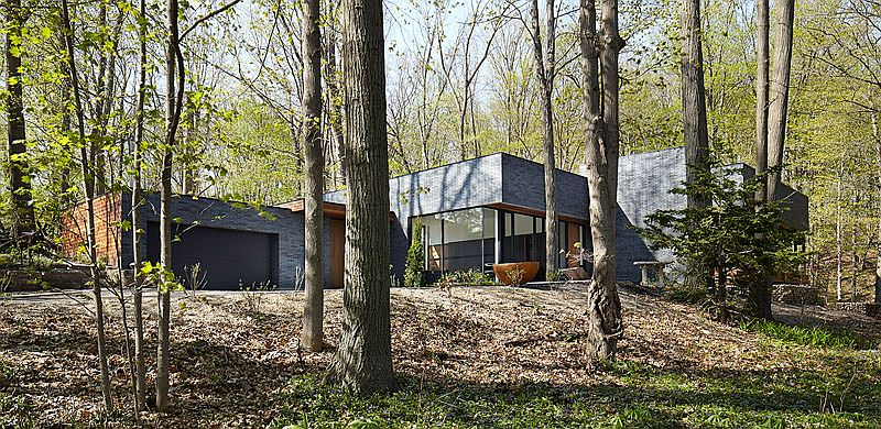 Natural greenery surrounds the contemporary Fallsview Residence in Dundas, Ontario, Canada