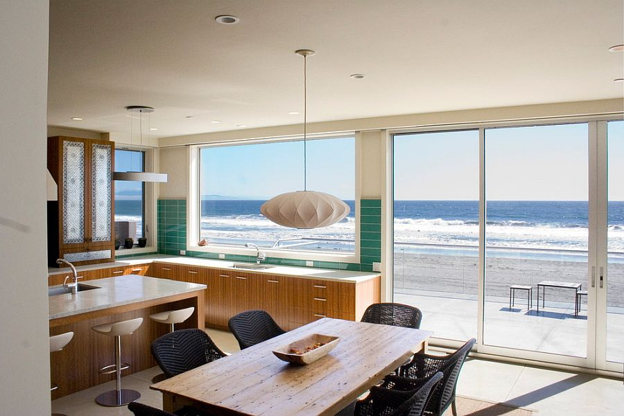 Ocean outside becomes a visual part of the beach style kitchen [Design: Polsky Perlstein Architects]