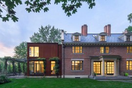 Old Georgian revival brick structure and modern extension in steel combined to create a modern home in Massachusetts