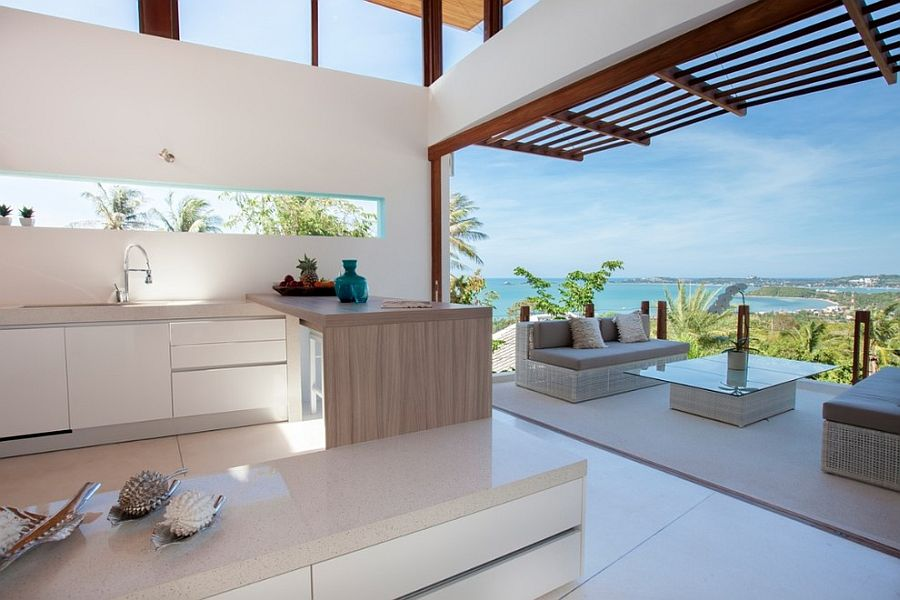 View in gallery Open plan living and kitchen with modern tropical style [ Design: Isabelle Robyns] & Visual Treat: 20 Captivating Kitchens with an Ocean View