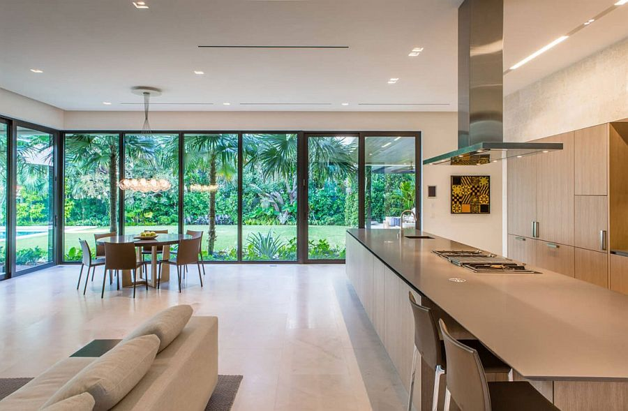 Open up the kitchen to the backyard with sliding glass doors