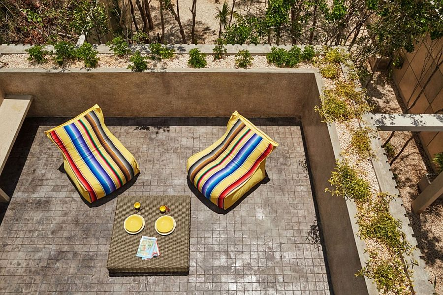 Outdoor decor adds color to the polished cement deck