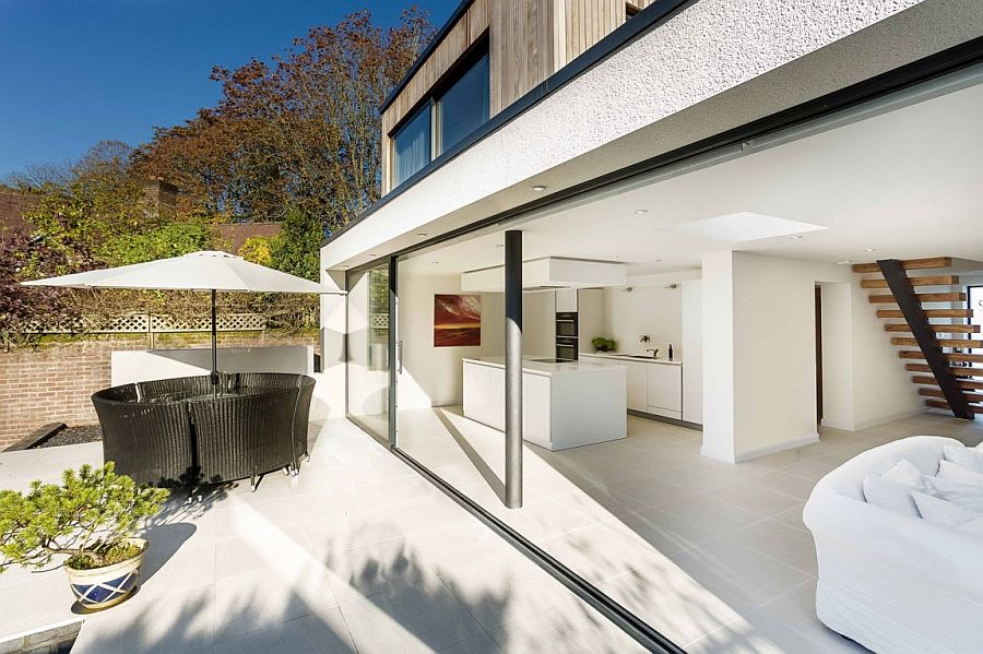 Outdoor sitting space and deck become an extension of the living area