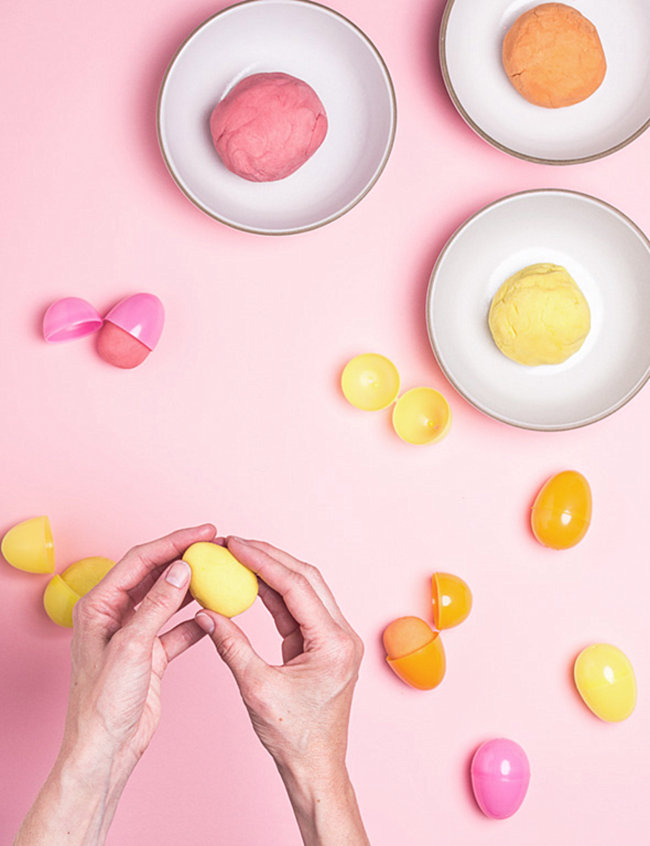 Pastel playdough in Easter eggs from Say Yes