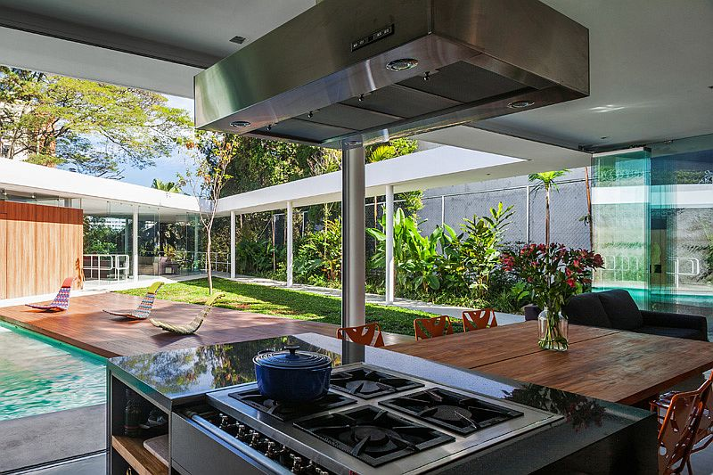 Pavilion-styled kitchen and dining area zone of the contemporary home