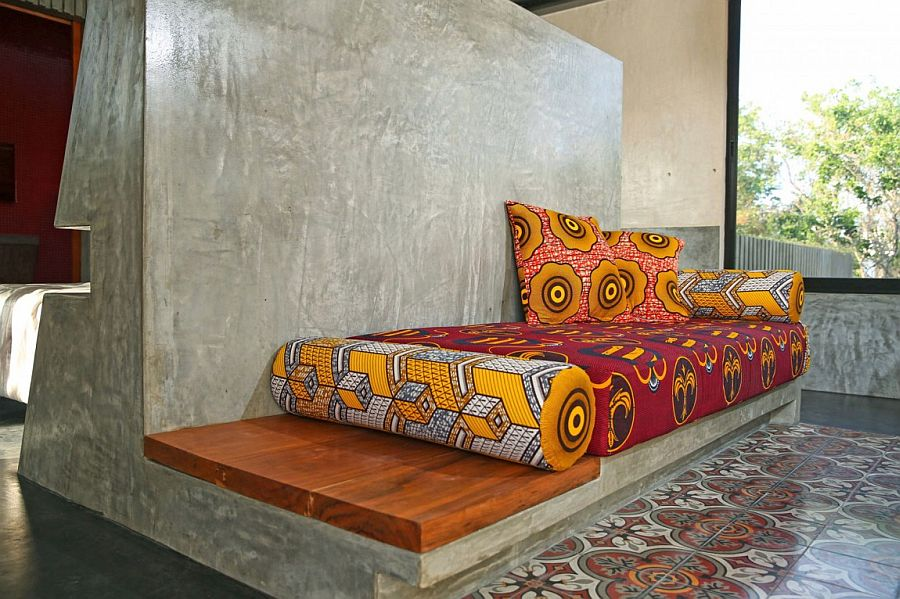 Polished cement seat and daybed with vivacious cushions