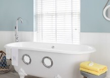 Porthole bath steals the show in this nautical themed bathroom 217x155 Trendy Twist to a Timeless Color Scheme: Bathrooms in Blue and Yellow