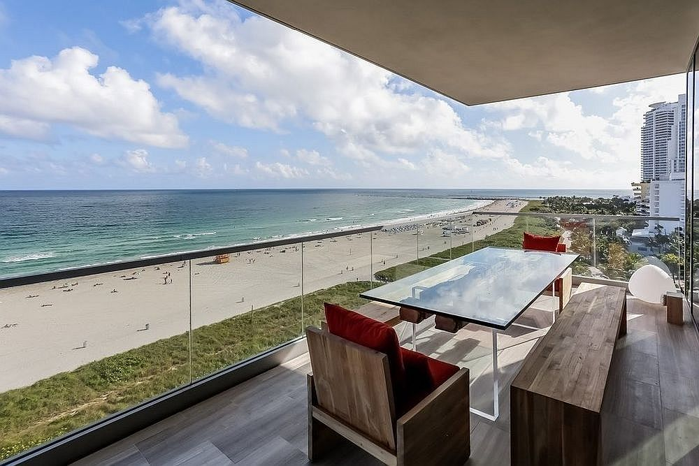 Private balcony of the penthouse overlooking the beach and the ocean
