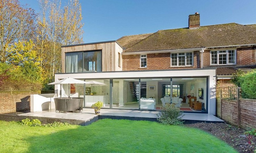Classic English Home with Brick Façade Acquires a Nifty Modern Extension
