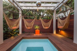 Relaxing and stylish tropical style pool deck and landscape