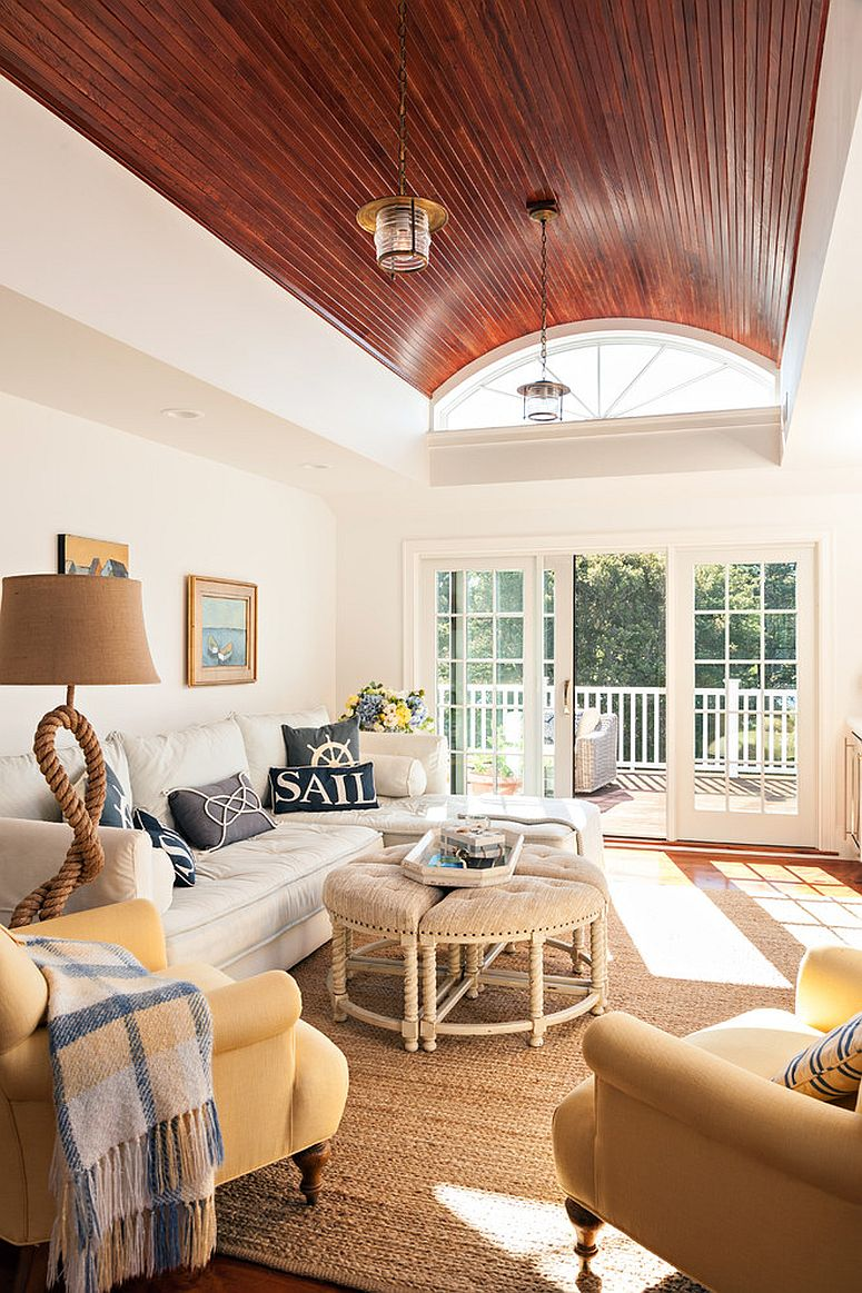 Rope lamp and throw pillows bring the coastal charm to this sunroom [Design: Gable Building Corp]