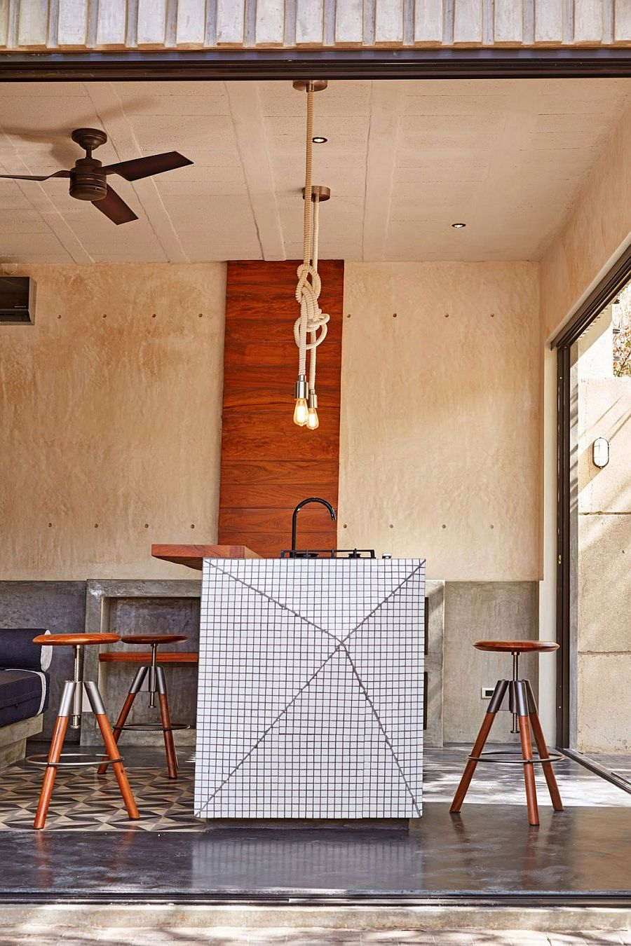 Rope pendants and fun stools give the kitchen a quirky look