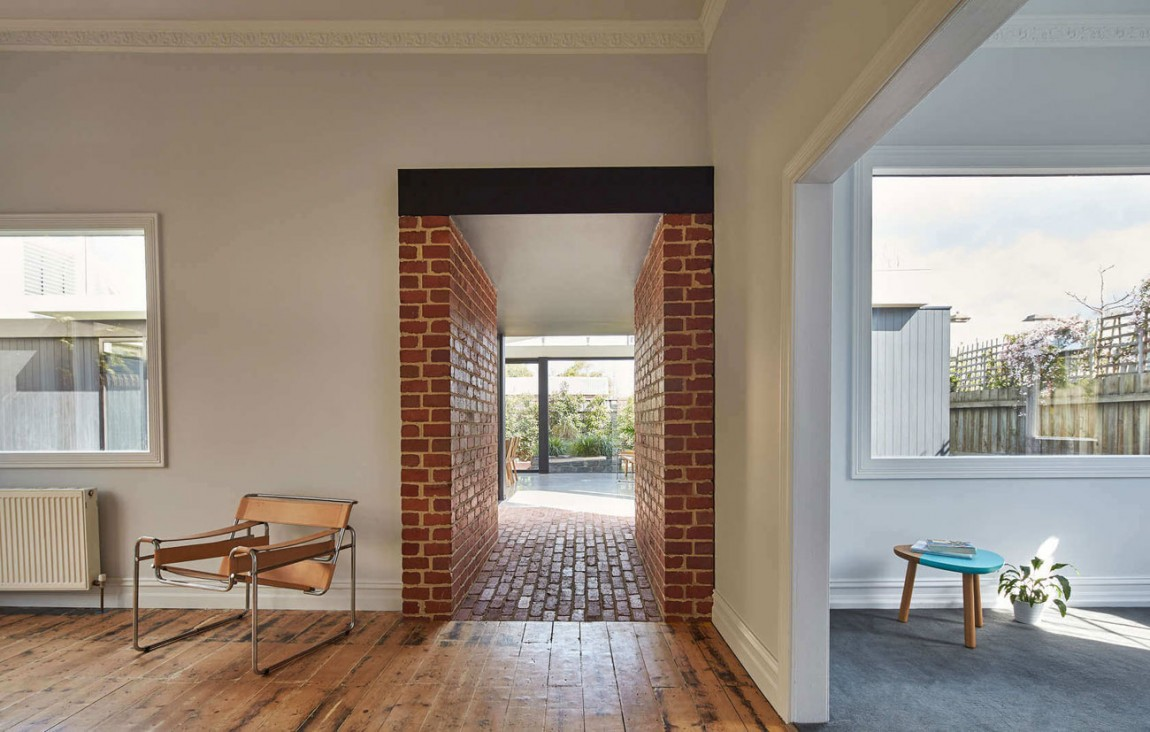 Salvaged brick used to create the tunnel that connects old and new structures inside the Hawthorn home