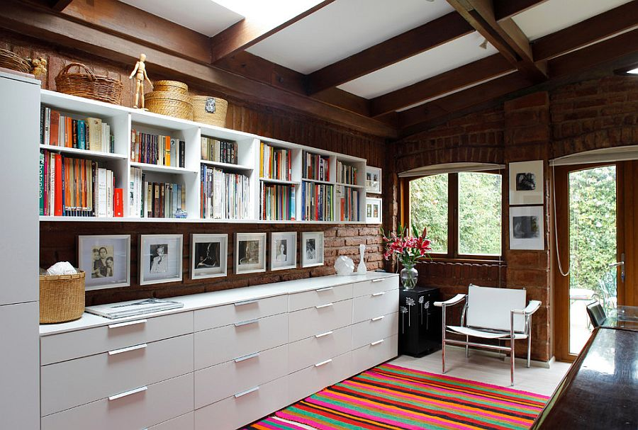 Series of open shelves and closed cabinets create ample storage space in this home office [Design: Carolina Katz + Paula Nuñez]